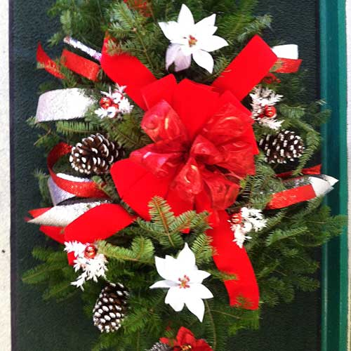 Christmas trees, poinsettias and festive holiday decor available at Tom Strain and Sons in Toledo, Ohio!